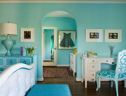 The monochromatic color scheme doesn't stifle the femininity of this room.  Oh, and I want that chair.